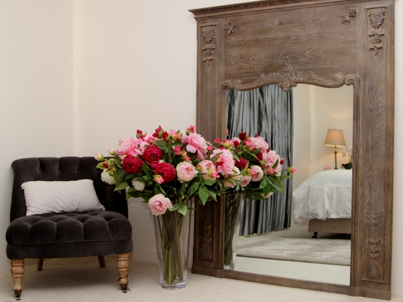 bedroom chair flowers and mirror